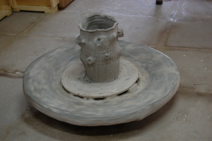 Foot operated pottery wheel.