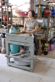 This is Mrs. Seh. She is the daughter in law of the original owners, who has brought much attention to this historic way of firing pottery.