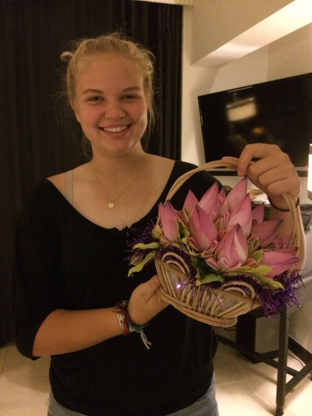 Emily received flowers from the hotel because she wasn't feeling well.